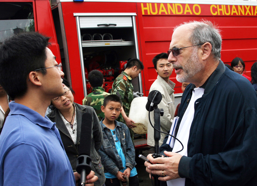 All Things Considered host Robert Siegel reporting after the Sichuan earthquake in China. Credit: NPR